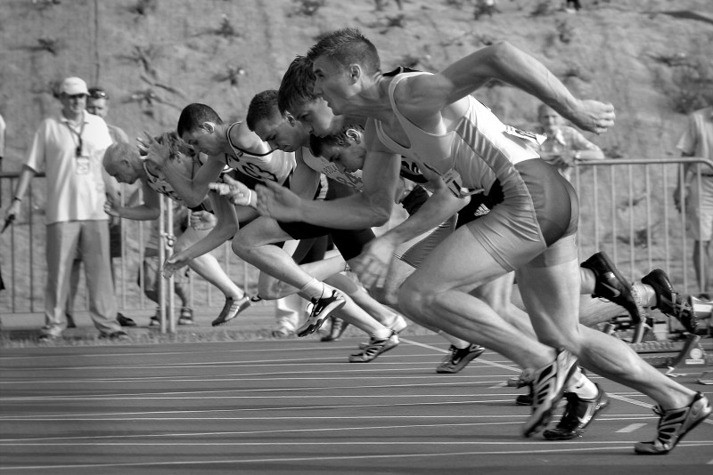 male-athletes-racing-bw